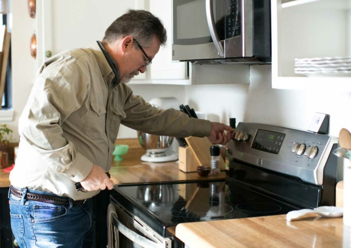 Randy Buster Inspecting electric range