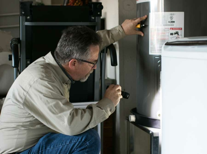 Randy Buster Inspecting Water Heater