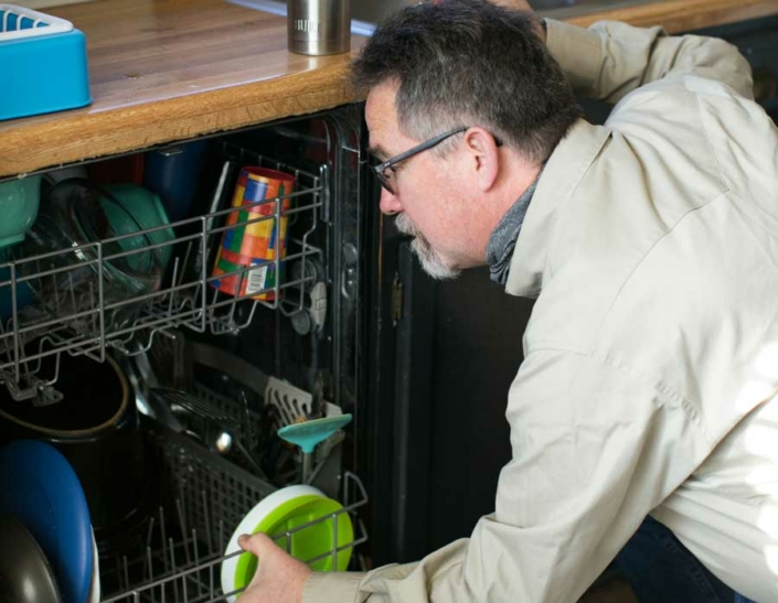 Randy Buster Inspecting Dish washer